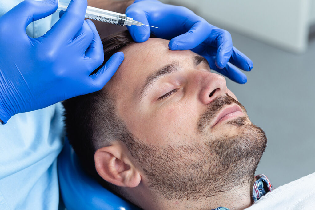 Injectable services - Man getting injectable to his scalp