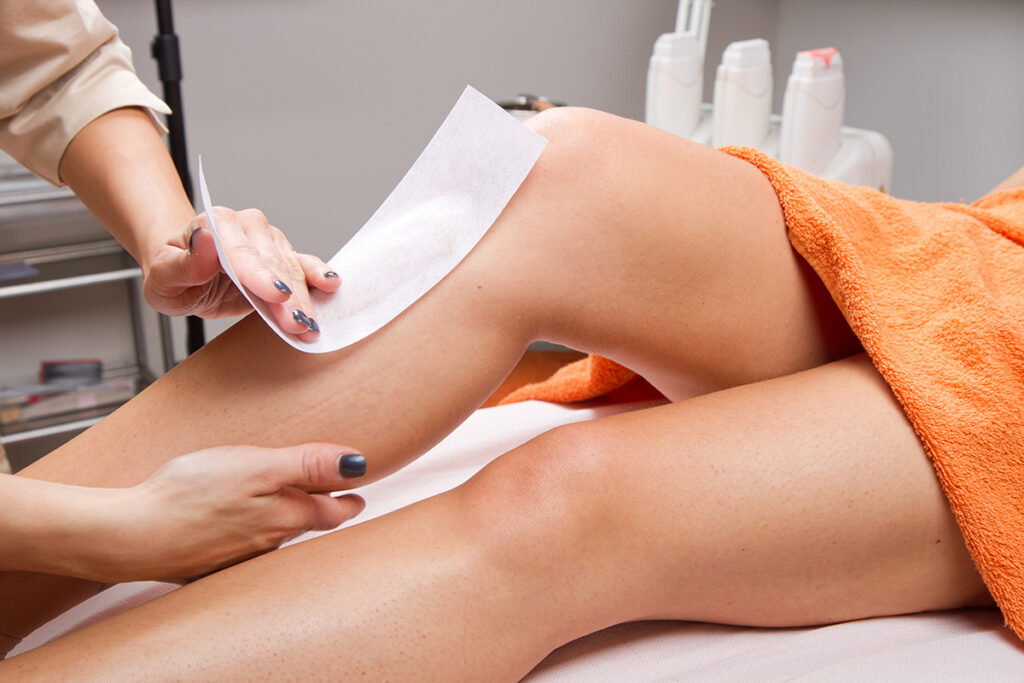 Photo of a woman getting a full body waxing on her legs