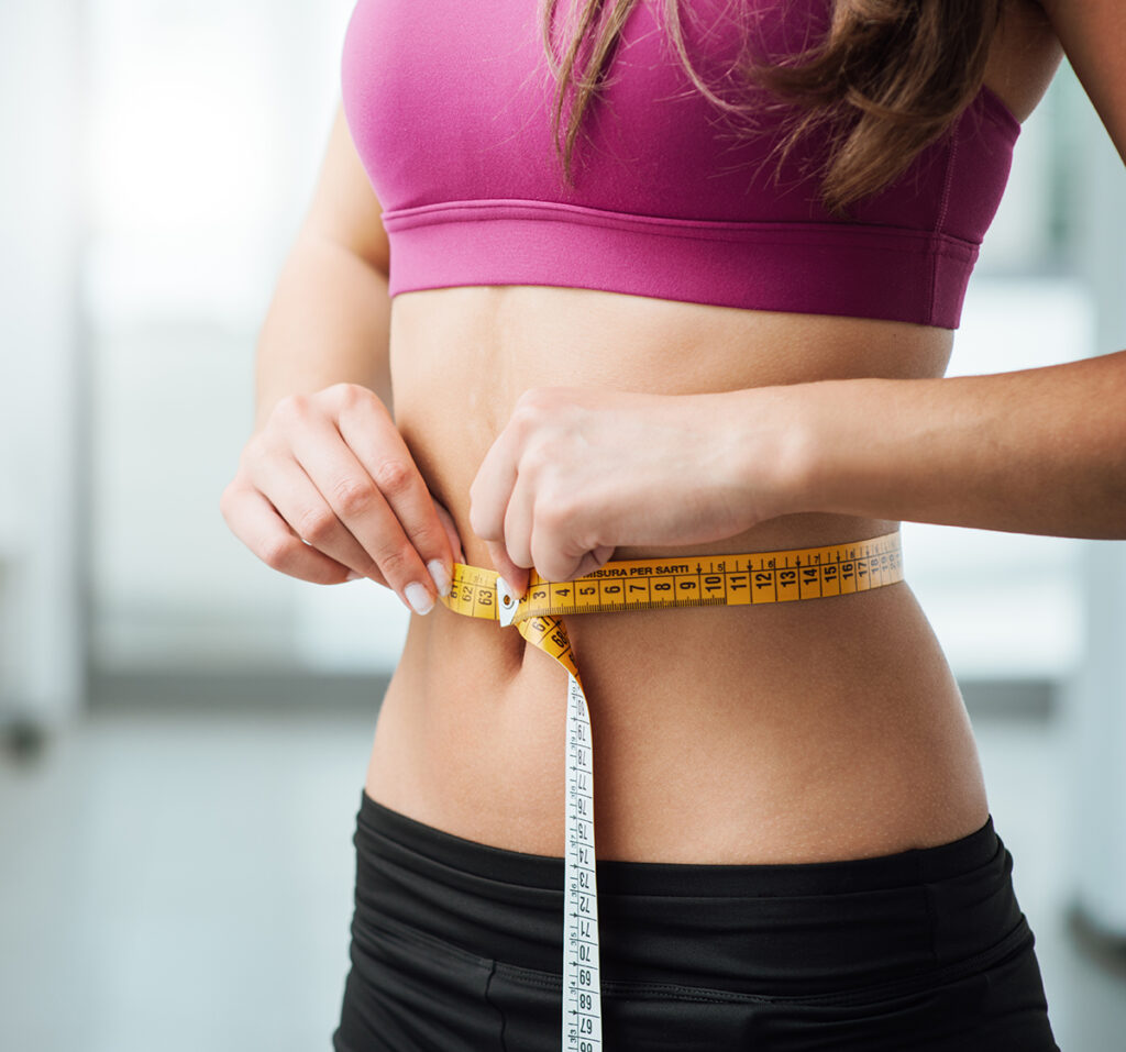Trusculpt Body Sculpting - Woman with tape measure around waist